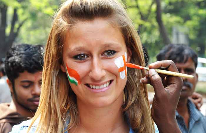 An England cricket fan gets her face painted. (AFP Photo)