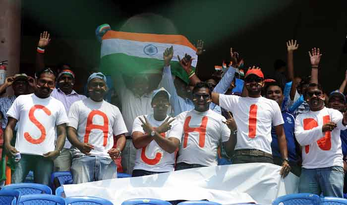 India fans cheers, wearing matching shirts spelling the first name of Sachin Tendulkar, cheer prior to the match. (AFP Photo)