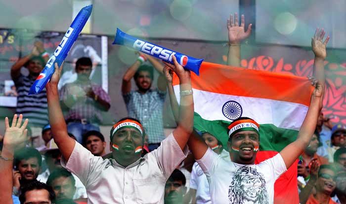 Indian cricket fans cheer in the stands before the start of the Cricket World Cup match between England and India. (AFP Photo)