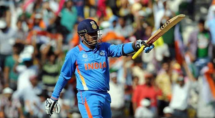 India batsman Virender Sehwag raises his bat after scoring a half century. (AFP Photo)