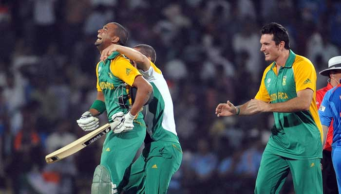South African players celebrate their 3-wicket win against India in their Pool B match on Saturday.