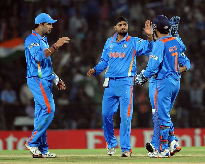 Indian players celebrate the dismissal of South Africa's Hashim Amla with Harbhajan Singh. (AFP PHOTO)