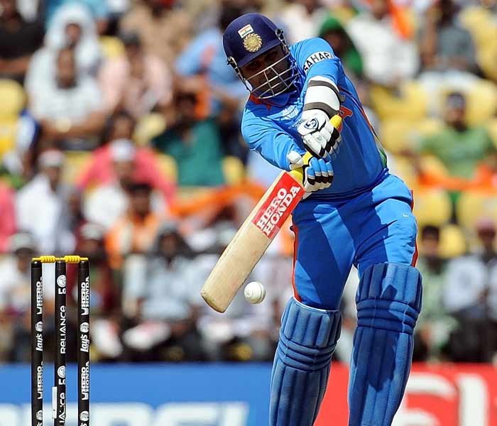 India batsman Virender Sehwag plays a shot during the Cricket World Cup match between India and South Africa. (AFP Photo)