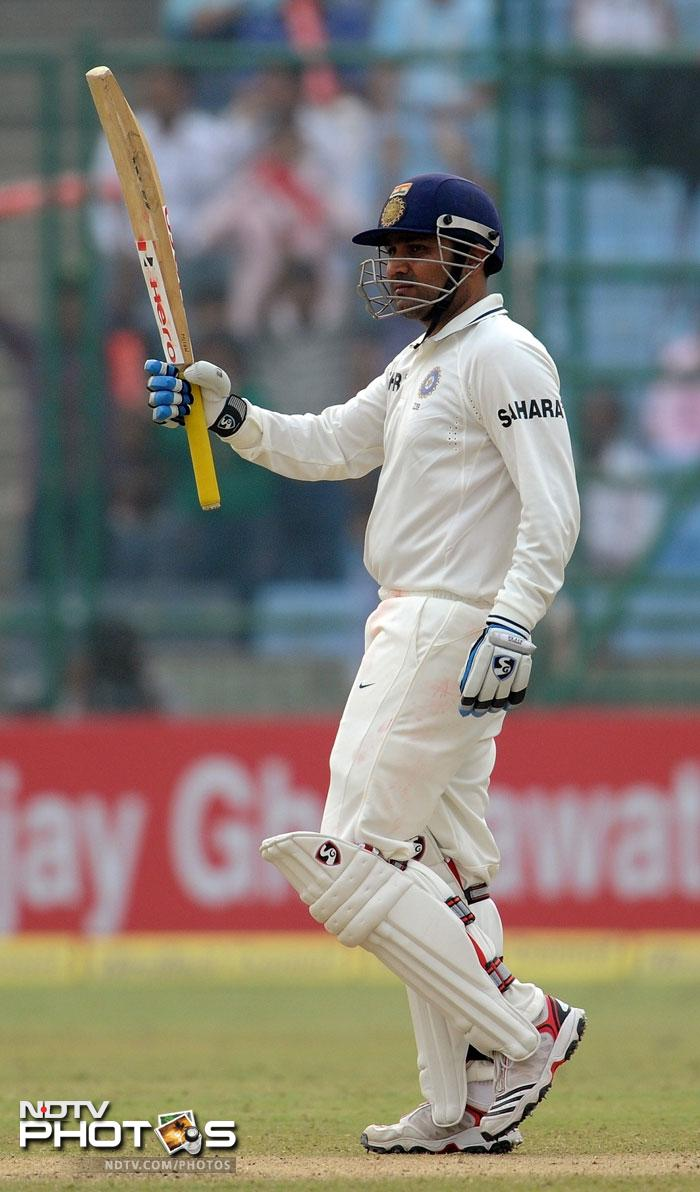 Gambhir departed but Sehwag went on to complete his fifty. It was his second fifty of the match. (AFP Photo)