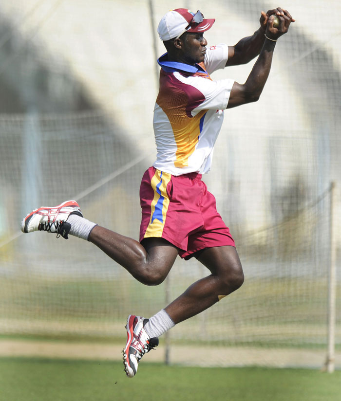 West Indies cricket captain Darren Sammy jumps in the air to take catch during a training session. (AFP Photo)
