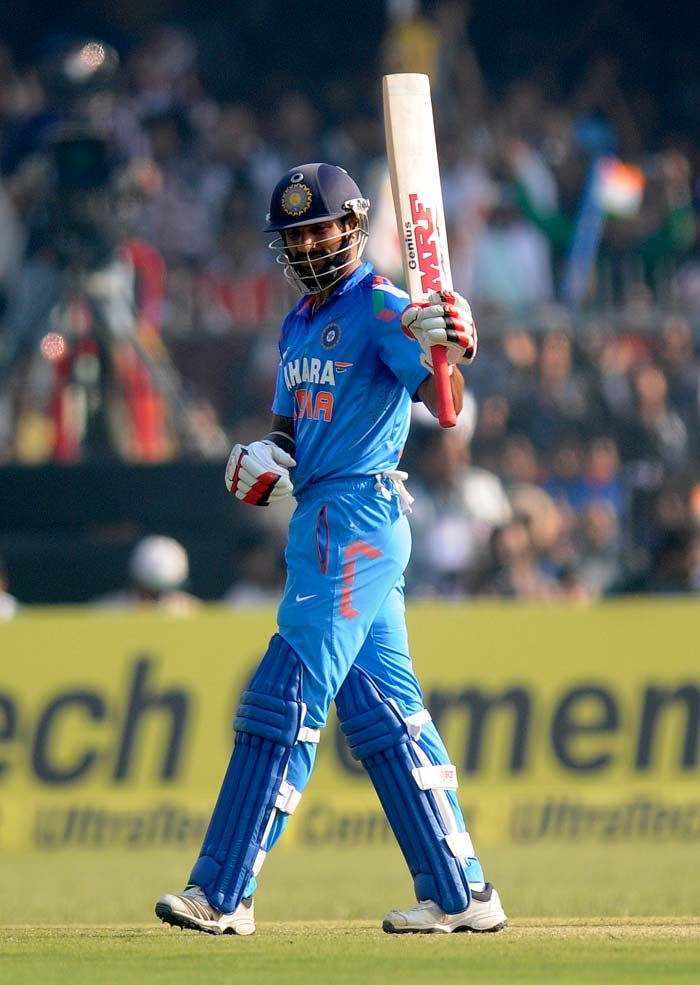 Shikhar Dhawan's 95-ball 119 guided India home with 23 balls to spare. The 27-year-old was involved in a 129-run third-wicket stand with Yuvraj Singh, who scored 55, his 51st ODI half-century.