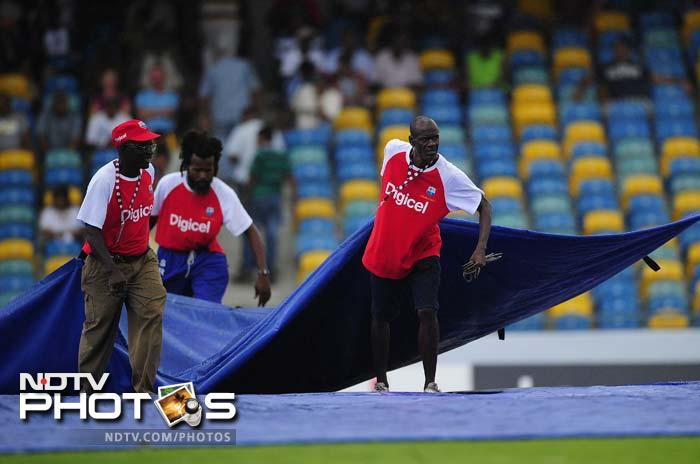 It was a tortuous day for both teams as the covers kept coming on and off without a chance for much play in the middle. (AFP Photo)