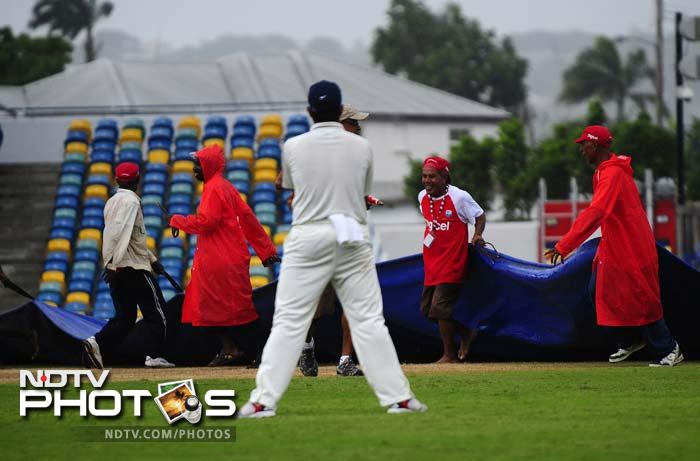 Rain stopped play at least 3 times and just 25.3 overs were possible on Wednesday. (AFP Photo)