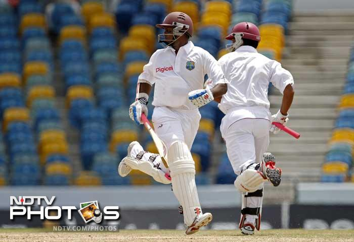 West Indies' middle-order batsmen Shivnarine Chanderpaul and Marlon Samuels fought hard in the middle, denying the Indian bowlers another success, before the rain came pouring. (AP Photo)