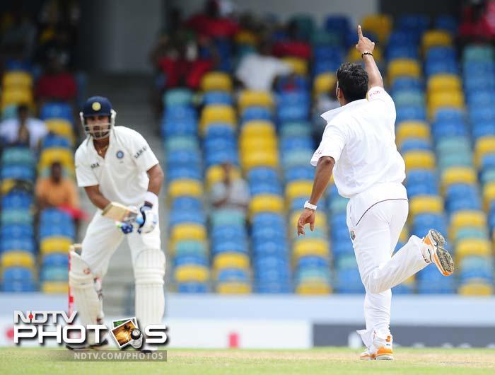 West Indies bowler Ravi Rampaul celebrates after taking the wicket of Indian batsman Murali Vijay. (AFP Photo)
