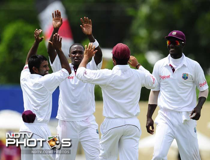 West Indies bowler Fidel Edwards (C) celebrates after taking the wicket of Indian batsman Abhinav Mukund, who missed out on his maiden Test fifty by 2 runs. (AFP Photo)