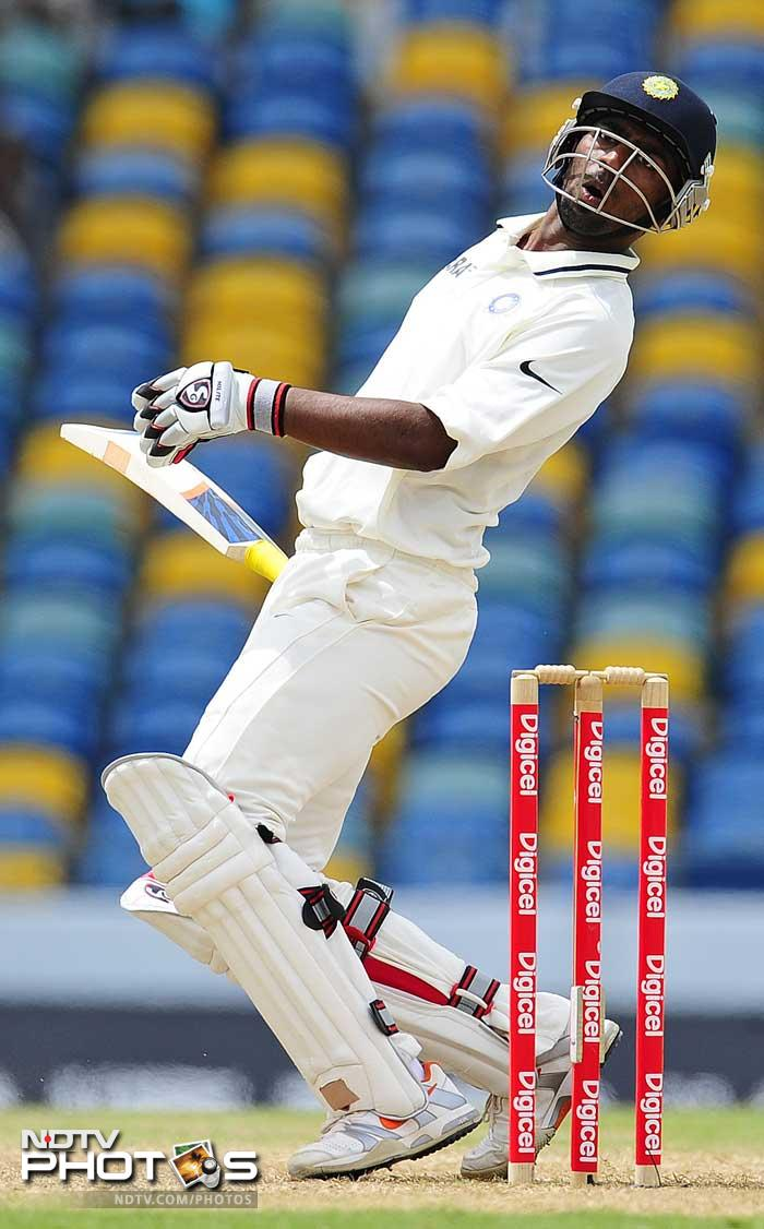 Abhinav Mukund plays on to a Fidel Edwards bouncer which costs him his wicket. (AFP Photo)