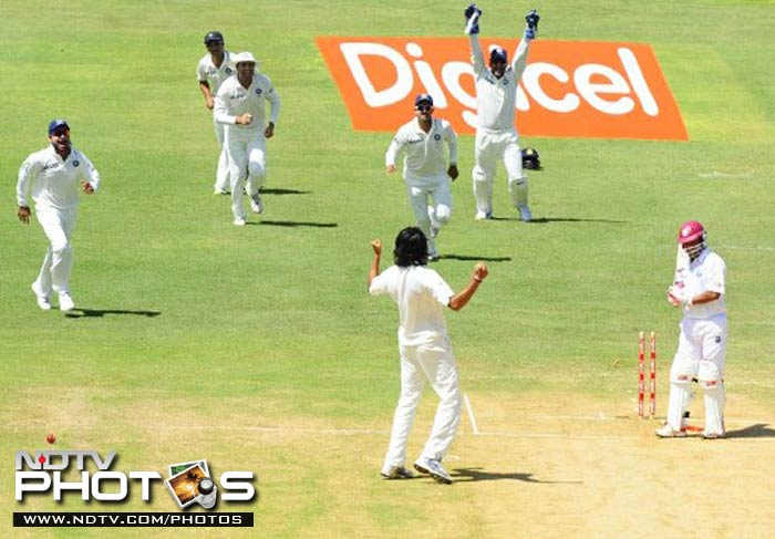 Ishant Sharma rejoices after picking up the first wicket of day 2 which came in the form of Ramnaresh Sarwan's.