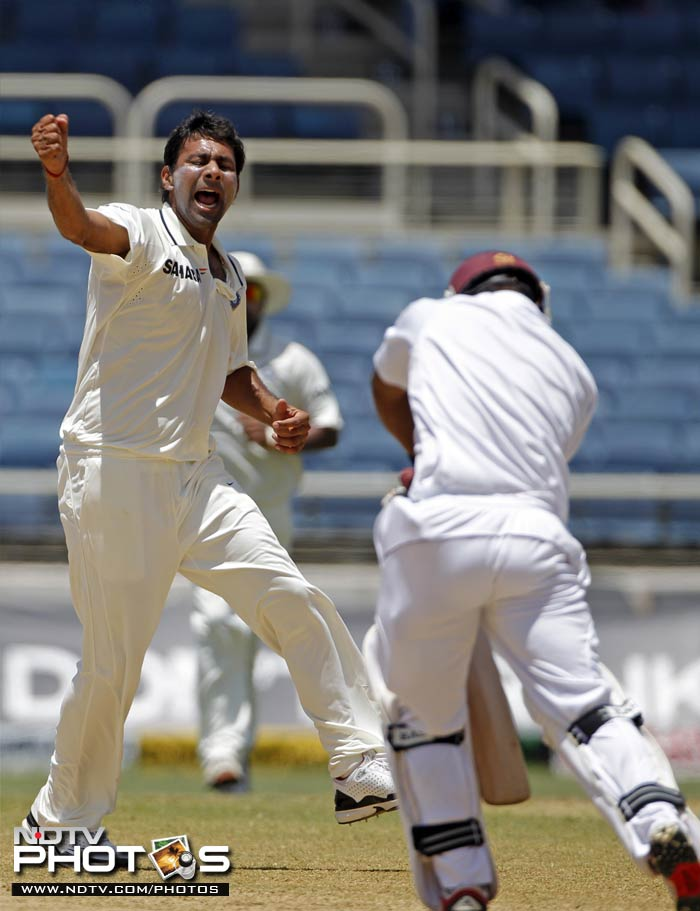 Praveen Kumar celebrates his first international Test wicket as he removes West Indies Adrian Barath at a score 0f 64 runs.