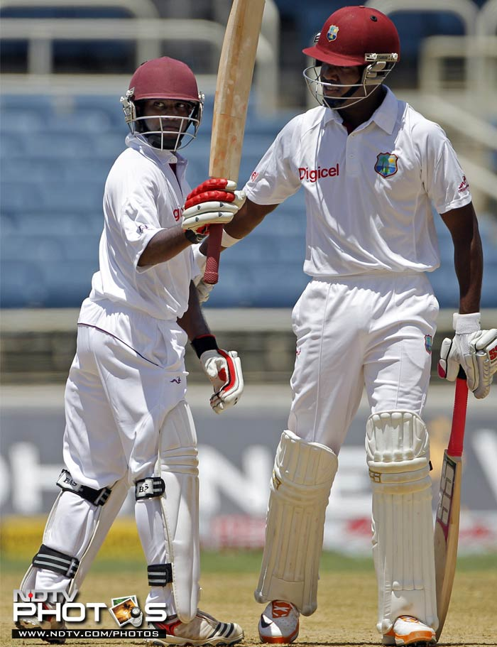 Opener Adrian Barath celebrates his half century as he is congratulated by teammate and batting partner Darren Bravo.