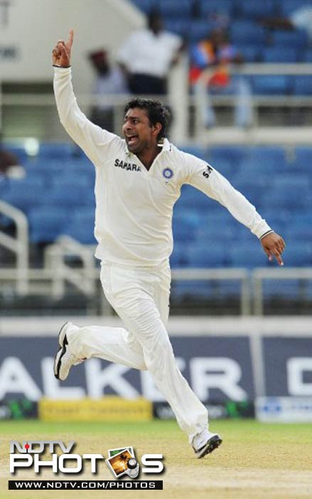 Praveen Kumar celebrates the wicket of Darren Bravo on the second day of the Test match.