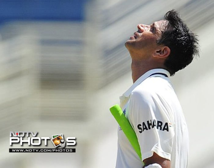 Indian batsman Rahul Dravid celebrates after scoring a century, the 32nd of his career, on the third day of the Test match.