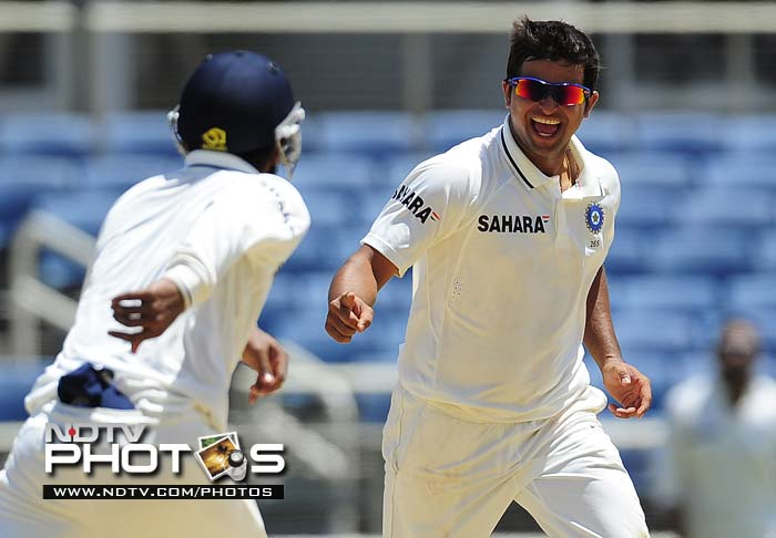 Indian bowler Suresh Raina celebrates after taking the last West Indian wicket of Devendra Bishoo, during the fourth day of the first Test match between West Indies and India at Sabina Park.
