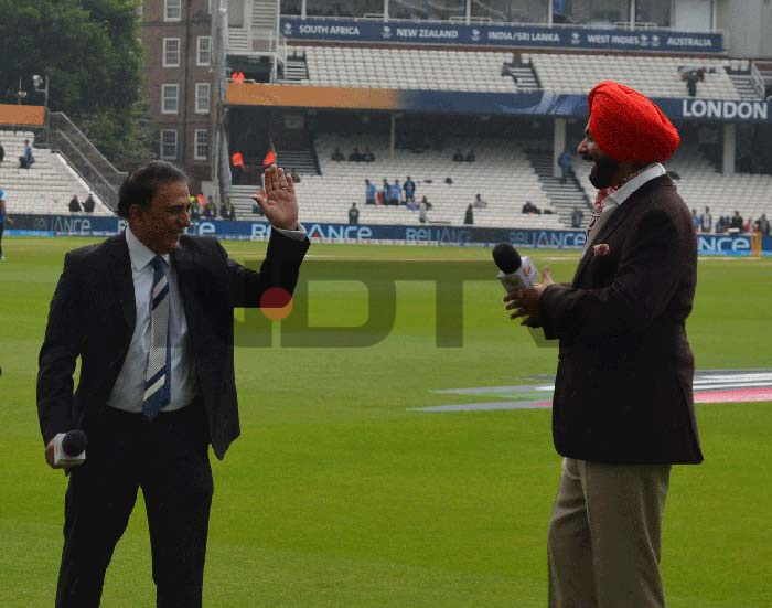 But as the sun peaks out at The Oval, so does Sunil Gavaskar's spirits. Seen here sharing a jovial moment with Sidhu.