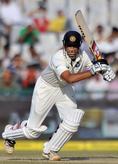 Indian cricketer Rahul Dravid plays a shot during the second day of the first Test between India and Australia in Mohali. (AFP Photo)