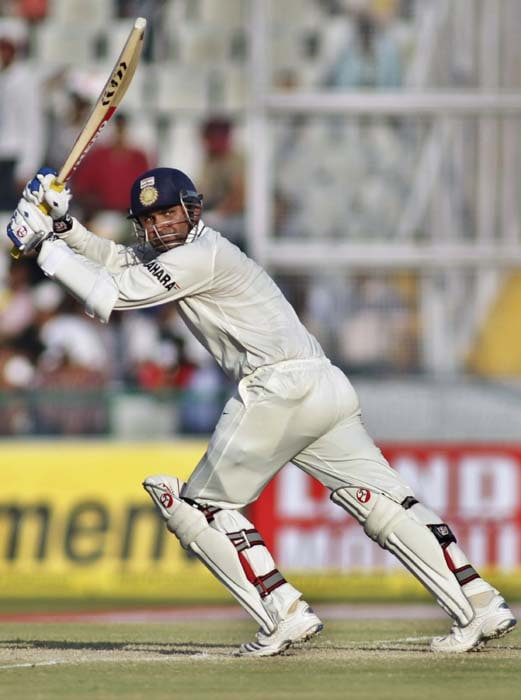India's Virender Sehwag bats during the second day of the first Test between India and Australia in Mohali. (AFP Photo)