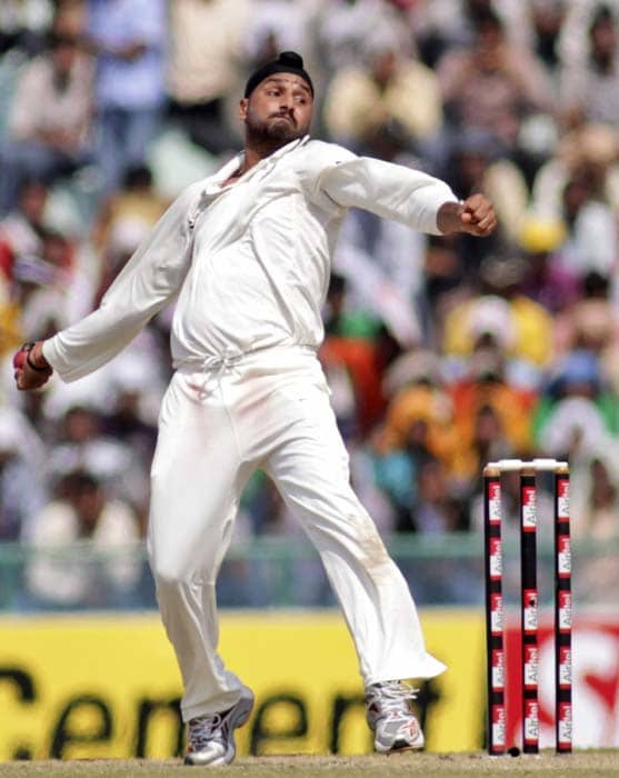 India's Harbhajan Singh bowls during the second day of the first Test between India and Australia in Mohali. (AFP Photo)