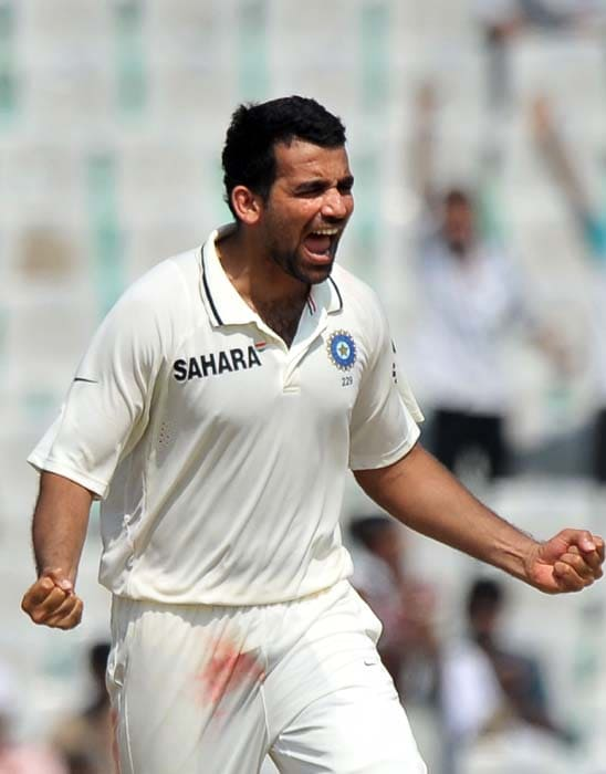 Indian cricket player Zaheer Khan celebrates the wicket of Australian cricketer Mitchell Johnson during the second day of the first Test between India and Australia in Mohali. (AFP Photo)