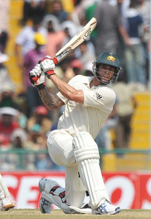 Australian cricketer Mitchell Johnson plays a shot, during the second day of the first Test between India and Australia in Mohali. (AFP Photo)