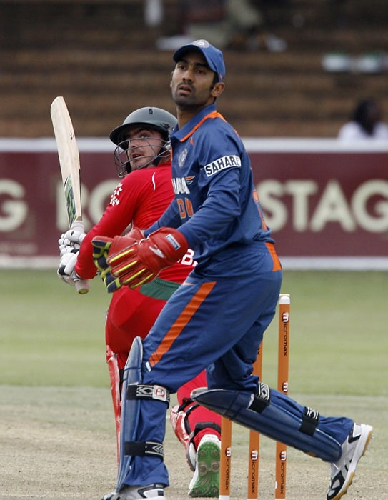 Zimbabwean Batsman Greg Lamb goes for a sweep shot which went past Indian wicket keeper Dinesh Karthik. (AFP Photo)
