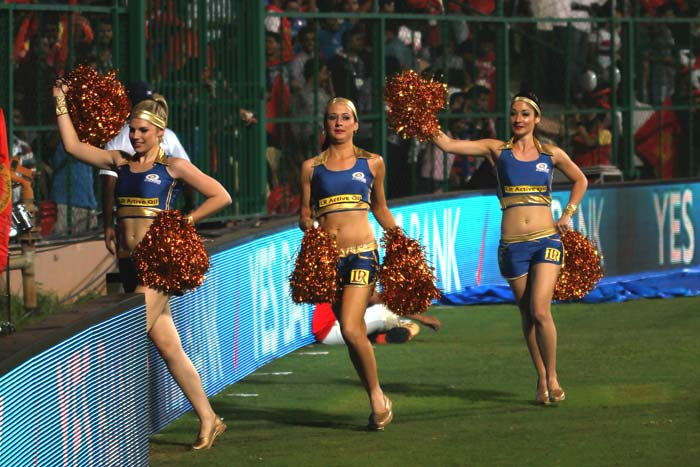 Mumbai Indians have not yet won the Indian Premier League title despite big names in the side. Their cheergirls have been working overtime during matches. (Images courtesy: BCCI and PTI)