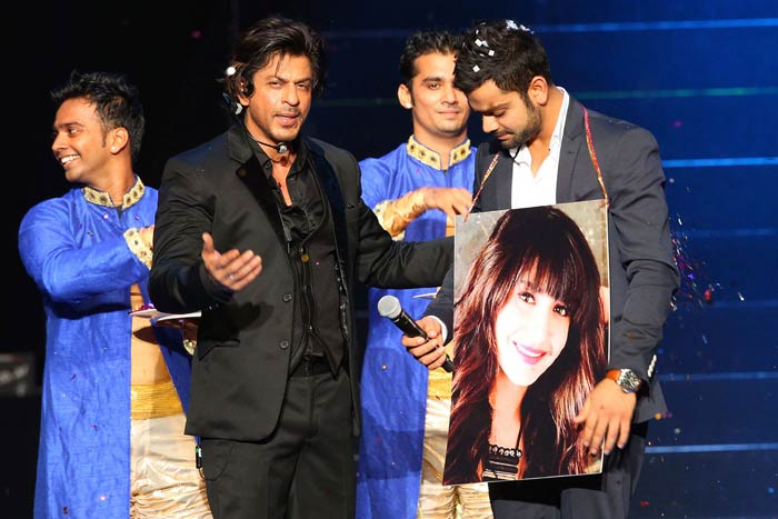 Rumoured to be dating Bollywood actress Anushka Sharma, Kohli chose her placard - a sign, a revelation or just surrendering to SRK's insistence? The jury is still out on that. (Image courtesy BCCI)