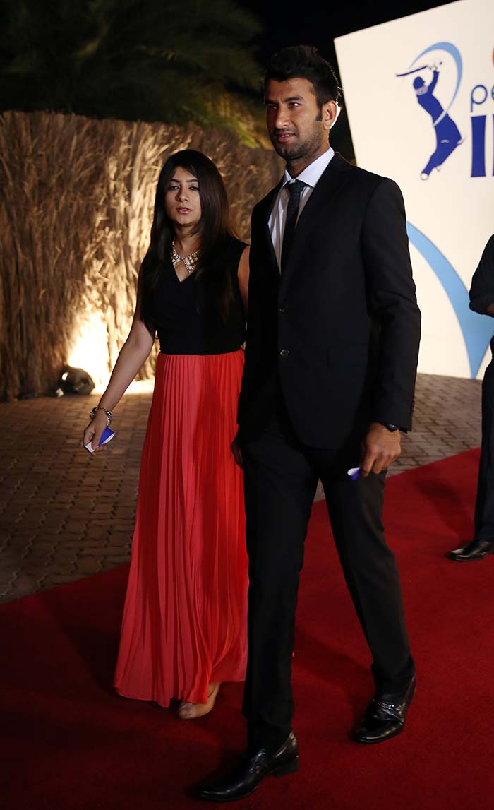 Cheteshwar Pujara is seen here with his wife Puja. <br><br>The Kings XI Punjab batsman decided to cement his relationship on February 13, 2013. (BCCI image)