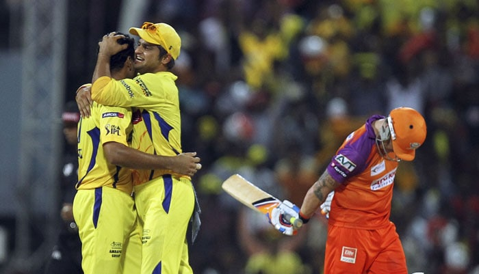 Shadab Jakati and Suresh Raina celebrate the dismissal of Brendon McCullum during their Indian Premier League match in Chennai. (AP Photo)