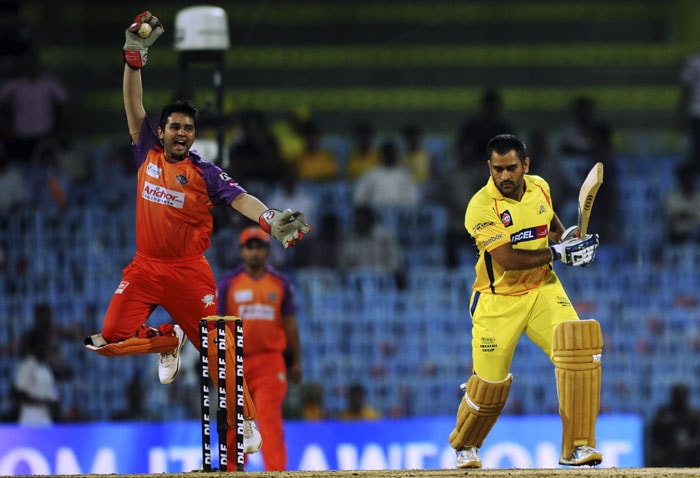 Parthiv Patel celebrates after taking the catch of Mahendra Singh Dhoni during the IPL Twenty20 match between Chennai Super Kings and Kochi Tuskers Kerala at the M.A.Chidambaram Stadium in Chennai. (AFP Photo)