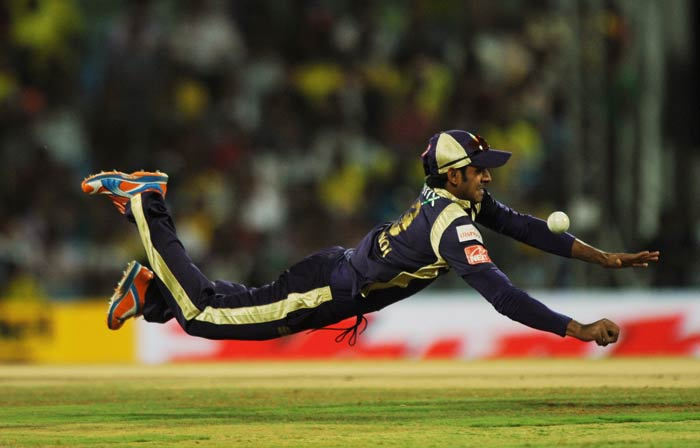 Manoj Tiwari dives to stop the ball during the IPL Twenty20 match between Chennai Super Kings and Kolkata Knight Riders at the M.A. Chidambaram Stadium in Chennai. (AFP Photo)