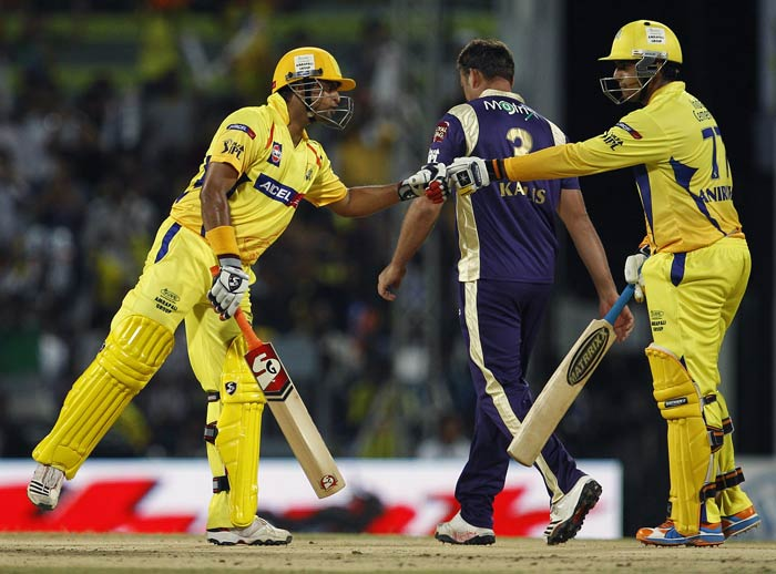 Suresh Raina greets teammate Anirudha Srikkanth on hitting a boundary off Jacques Kallis during the IPL match between Chennai Super Kings and Kolkata Knight Riders in Chennai. (AP Photo)