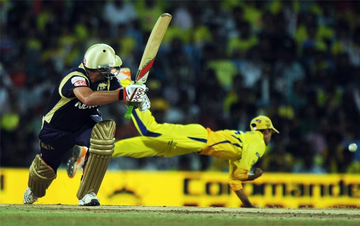 Kolkata Knight Riders batsman Jacques Kallis plays a shot as Chennai Super Kings feilder Kuthethur Vasudevadas (R) dives to stop the ball at the M.A. Chidambaram Stadium in Chennai. (AFP PHOTO)