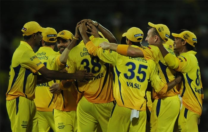 Chennai Super Kings players celebrate their win during the IPL Twenty20 match against Kolkata Knight Riders at the M.A. Chidambaram Stadium in Chennai. (AFP PHOTO)
