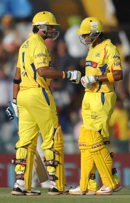 Murali Vijay and Subramaniam Badrinath pat each other during the IPL Twenty20 match between Chennai Super Kings and Kings XI Punjab at the Punjab Cricket Association Stadium in Mohali. (AFP Photo)