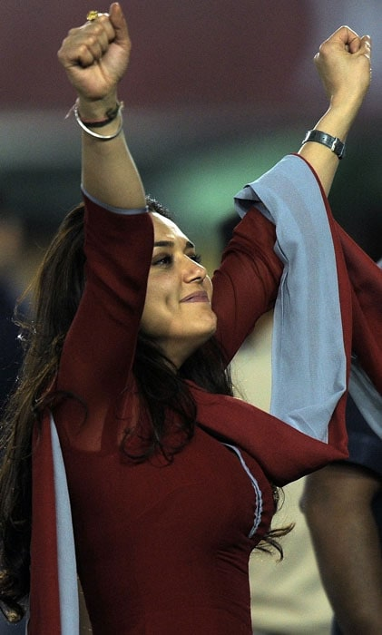 Kings XI Punjab co-owner Priety Zinta celebrates after winning the IPL Twenty20 match against Chennai Superkings at the Punjab Cricket Association (PCA) stadium in Mohali. KingsXI Punjab beat Chennai Superkings by 6 wickets. (AFP PHOTO)