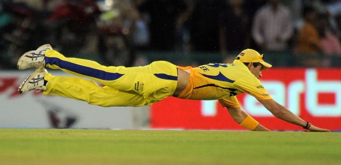 Chennai Super Kings cricketer Tim Southee dives to stop a shot during the IPL Twenty20 match against Kings XI Punjab at the Punjab Cricket Association (PCA) stadium in Mohali. (AFP PHOTO)