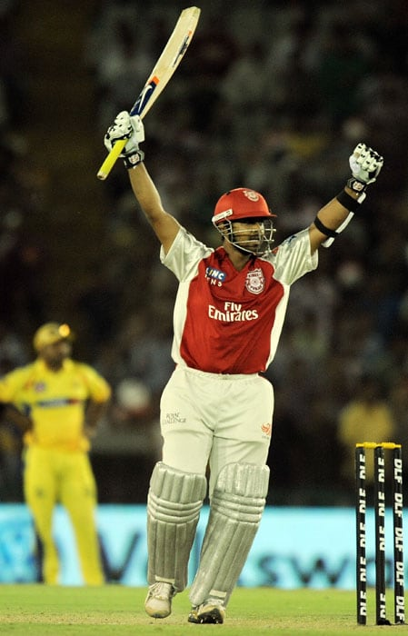 Kings XI Punjab batsman Paul Valthaty celebrates after scoring a century (100 runs), the first in IPL 2011, during the IPL Twenty20 match against Chennai Super Kings at the Punjab Cricket Association (PCA) stadium in Mohali. (AFP PHOTO)