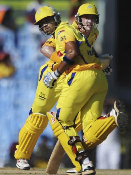 Michael Hussey and Murli Vijay run between wickets during the IPL Twenty20 match between Chennai Super Kings and Royal Challengers Bangalore at the M.A. Chidambaram Stadium in Chennai. (AFP Photo)