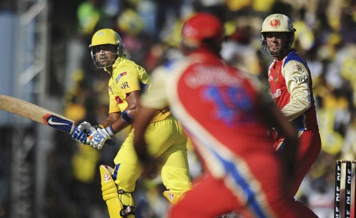 Murali Vijay is watched by AB de Villiers as he plays a shot during the IPL Twenty20 match between Chennai Super Kings and Royal Challengers Bangalore at the M.A. Chidambaram Stadium in Chennai. (AFP Photo)