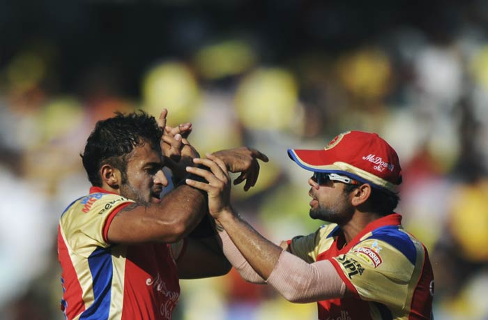 Ryan Ninan and Virat Kohli celebrate the wicket of Murali Vijay during the IPL Twenty20 match between Chennai Super Kings and Royal Challengers Bangalore at the M.A. Chidambaram Stadium in Chennai. (AFP Photo)