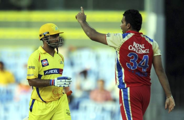 Zaheer Khan celebrates the wicket of Mahendra Singh Dhoni during the IPL Twenty20 match between Chennai Super Kings and Royal Challengers Bangalore at the M.A. Chidambaram Stadium in Chennai. (AFP Photo)