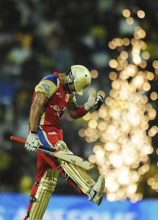 Virat Kohli reacts as he walks back to the pavilion after losing his wicket during the IPL Twenty20 match between Chennai Super Kings and Royal Challengers Bangalore at the M.A. Chidambaram Stadium in Chennai. (AFP Photo)