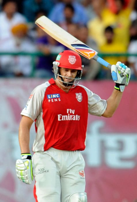 Adam Gilchrist waves his bat to the crowd as he celebrates scoring a half-century (50 runs) during the IPL match between Deccan Chargers and Kings XI Punjab at the Himachal Pradesh Cricket Association Stadium in Dharamsala. (AFP Photo)