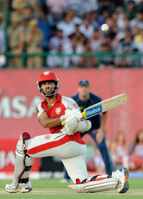 Dinesh Karthik plays a stroke during the IPL match between Deccan Chargers and Kings XI Punjab at the Himachal Pradesh Cricket Association Stadium in Dharamsala. (AFP Photo)