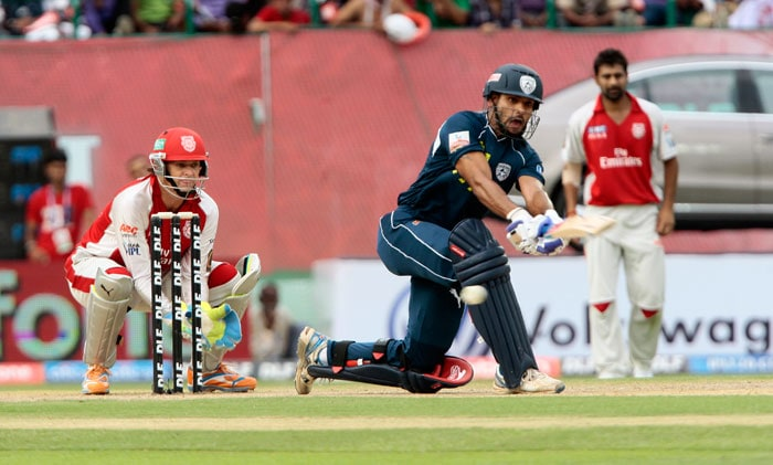 Shikhar Dhawan plays a stroke past Adam Gilchrist during the IPL cricket match between Deccan Chargers and Kings XI Punjab at the Himachal Pradesh Cricket Association Stadium in Dharamsala. (AFP Photo)